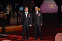 Mr. Donald Tsang, officiating guest and Sir Run Run Shaw, founder of the Shaw Prize, arrive at the Grand Hall