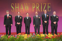 Mr Donald Tsang taking group photo with the Laureates 2010 on stage at the Award Presentation Ceremony 2010