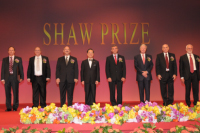 Mr Donald Tsang taking group photo with the Laureates 2011 on stage at the Award Presentation Ceremony 2011