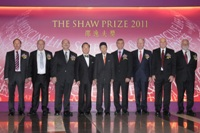 Mr Donald Tsang and Mr Run Run Shaw taking group photo with Shaw Laureates 2011 at the Award Presentation Ceremony