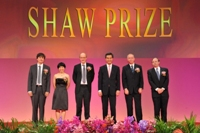 Mr C Y Leung taking group photo with the Laureates 2012 on stage at the Award Presentation Ceremony 2012