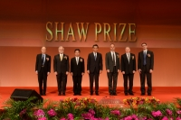 Mr C Y Leung taking group photo with the Laureates 2014 on stage at the Award Presentation Ceremony 2014